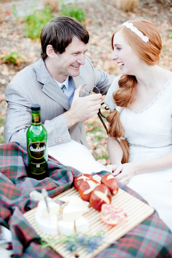 Bride and groom drink whisky