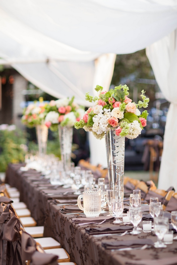 Wedding table flowers in tall vases