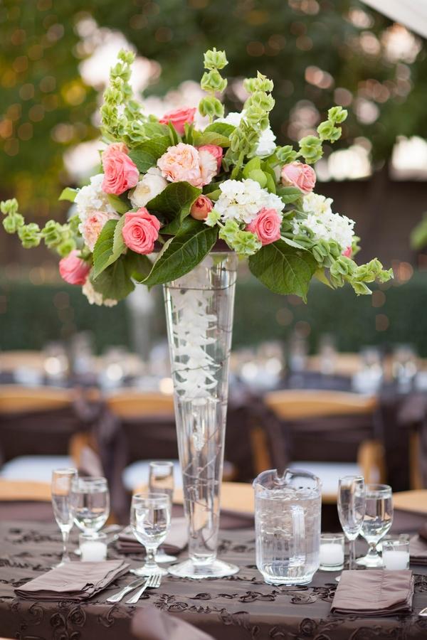 Tall vase of wedding table flowers