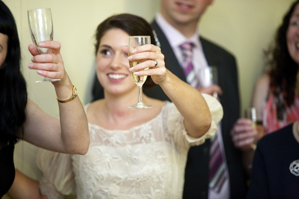 Bride raising glass to toast
