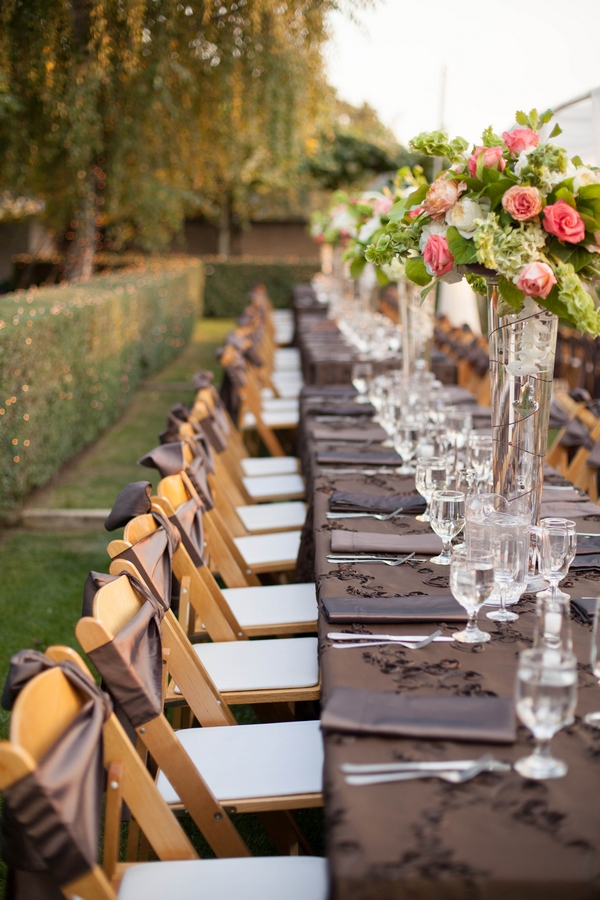 Seats along banquet style wedding table