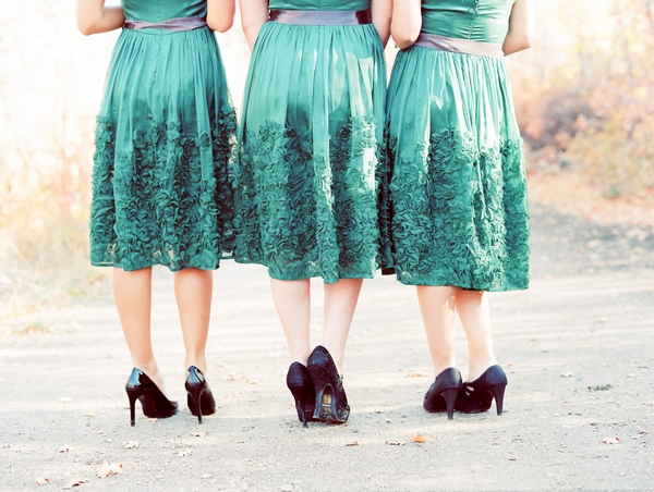 Back of bridesmaids in green dresses