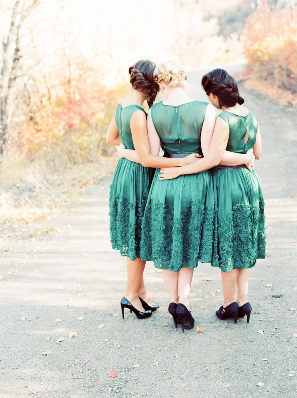 Bridesmaids with arms around each other