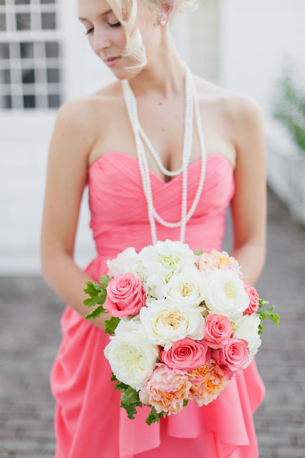 Bridesmaid in pink dress holding bouquet