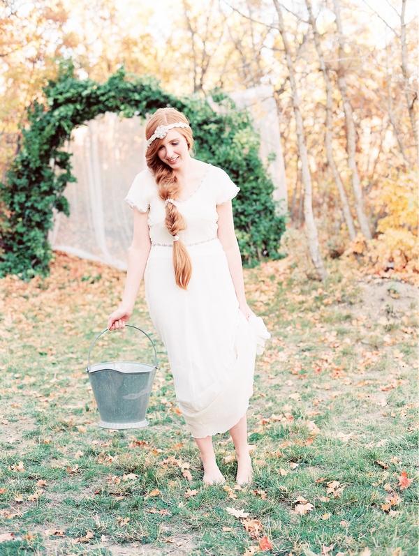 Bride carrying bucket