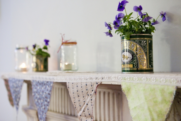 Golden syrup tin used as vintage wedding plant pot