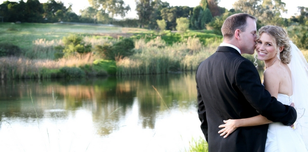 Bride and groom by lake in SouthAfrica