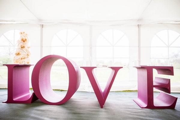 Large purple LOVE letters
