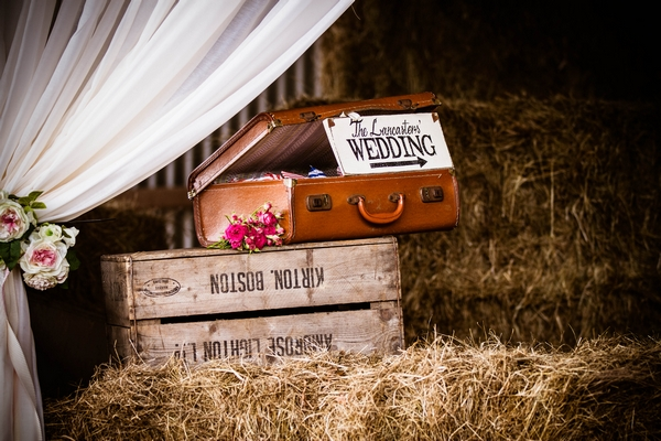 Vintage suitcases on hay bales