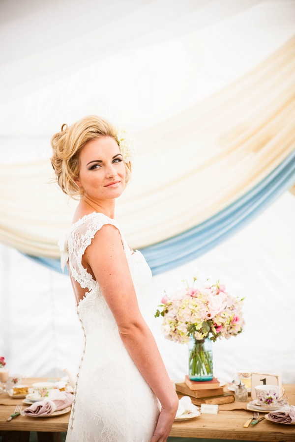 Bride standing in front of table