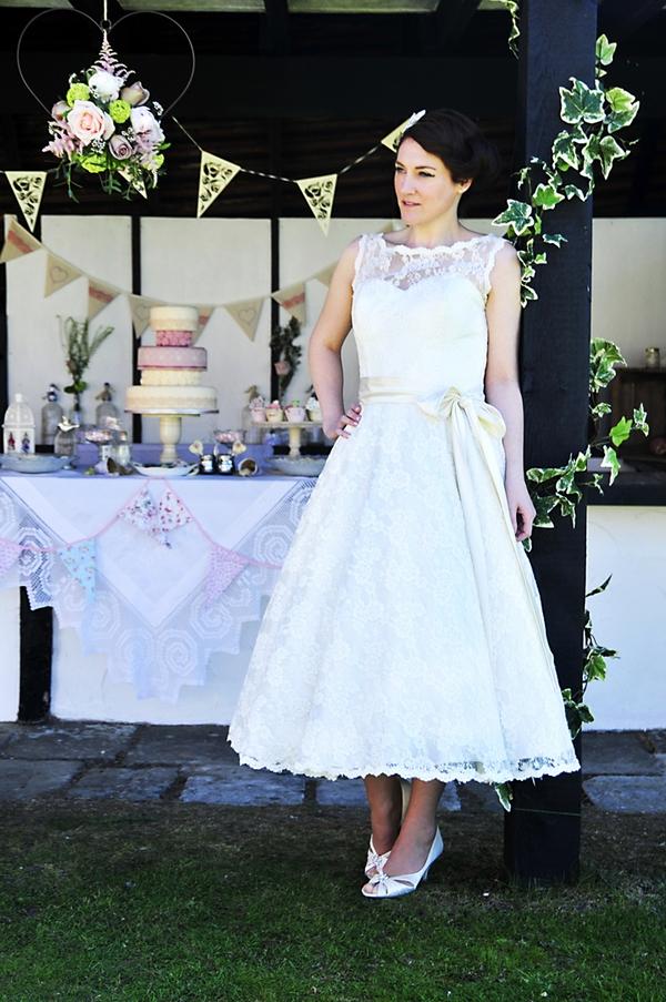 Bride standing next to pillar
