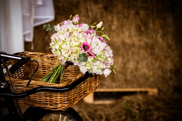 Wedding bouquet in basket of vintage bicycle