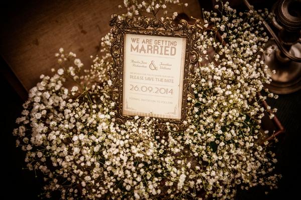 Flowers around wedding sign