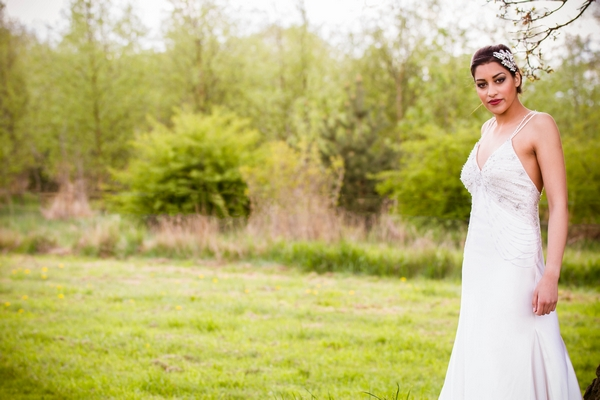 Bride standing on grass