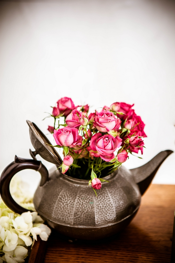 Teapot with flowers in it