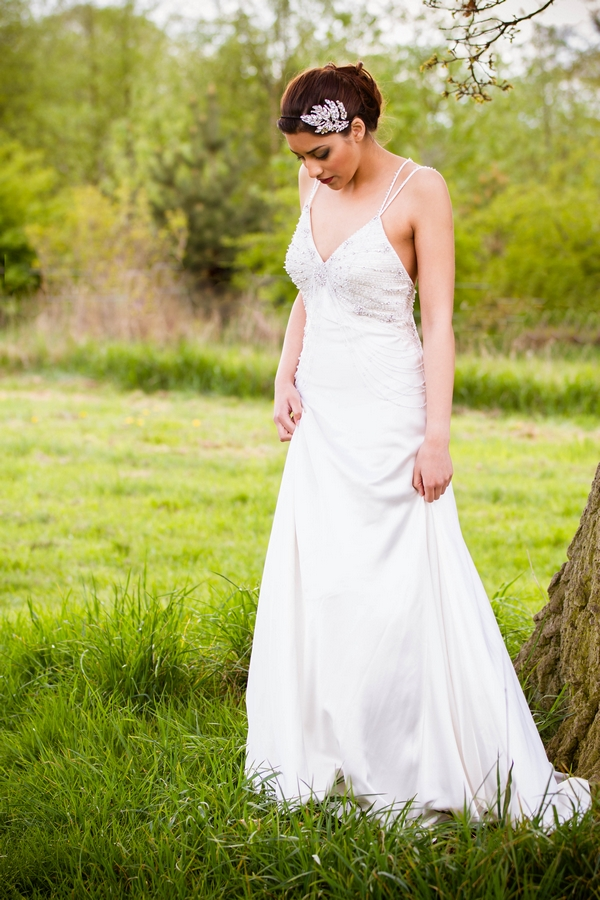 Bride looking down at grass
