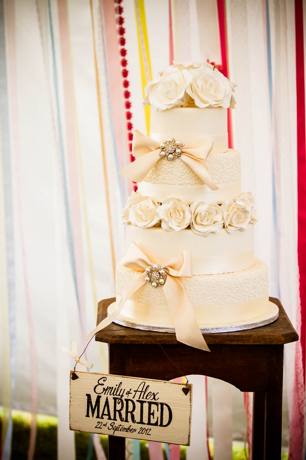 Rose and bow cream wedding cake