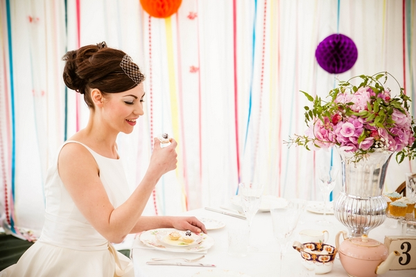 Bride about to eat cupcake