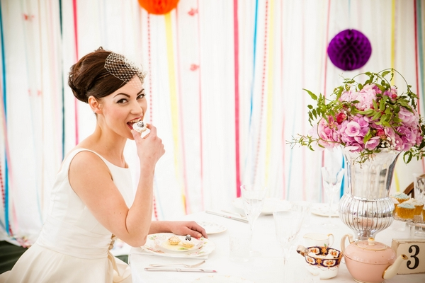 Bride eating cupcake