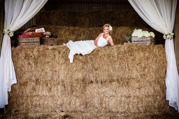 Bride layig on hay bales