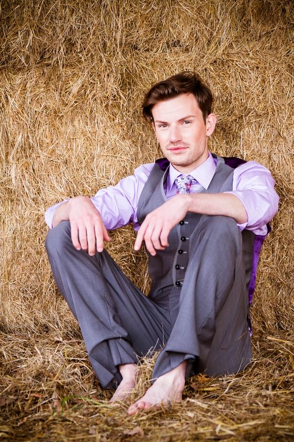 Groom sitting on hay