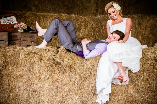 Groom laying in bride's lap