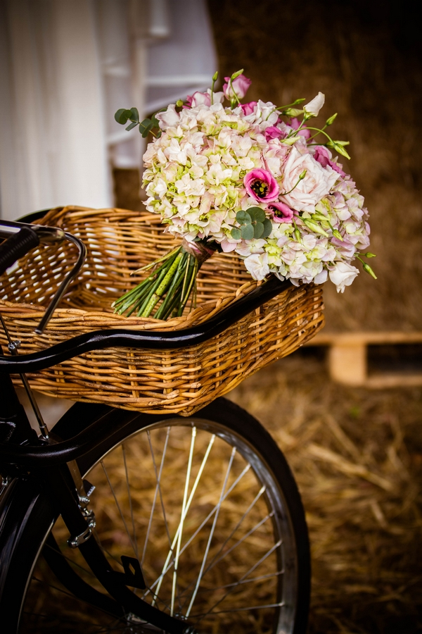 Wedding bouquet in bicycle basket