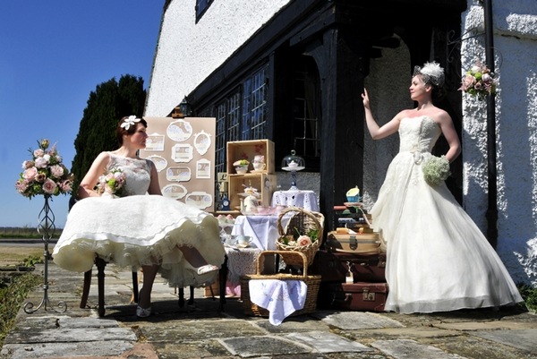 Two brides with wedding props