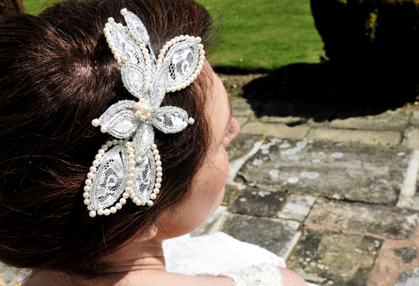 Bride with lace flower hairpiece