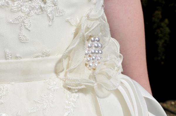 Flower on bride's dress