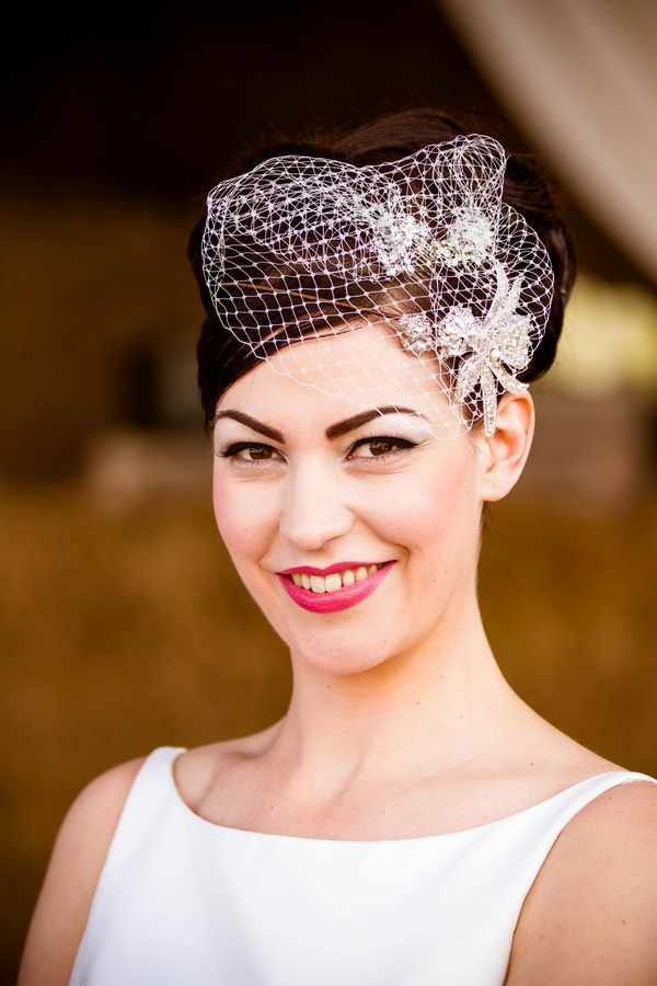 Vintage bride wearing birdcage fascinator