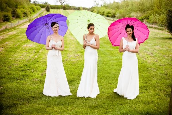 Brides with coloured umbrellas