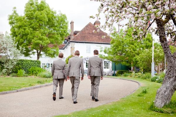 Groomsmen walking to wedding venue
