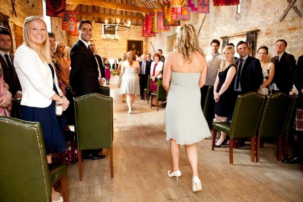 Bridesmaid walking into wedding ceremony
