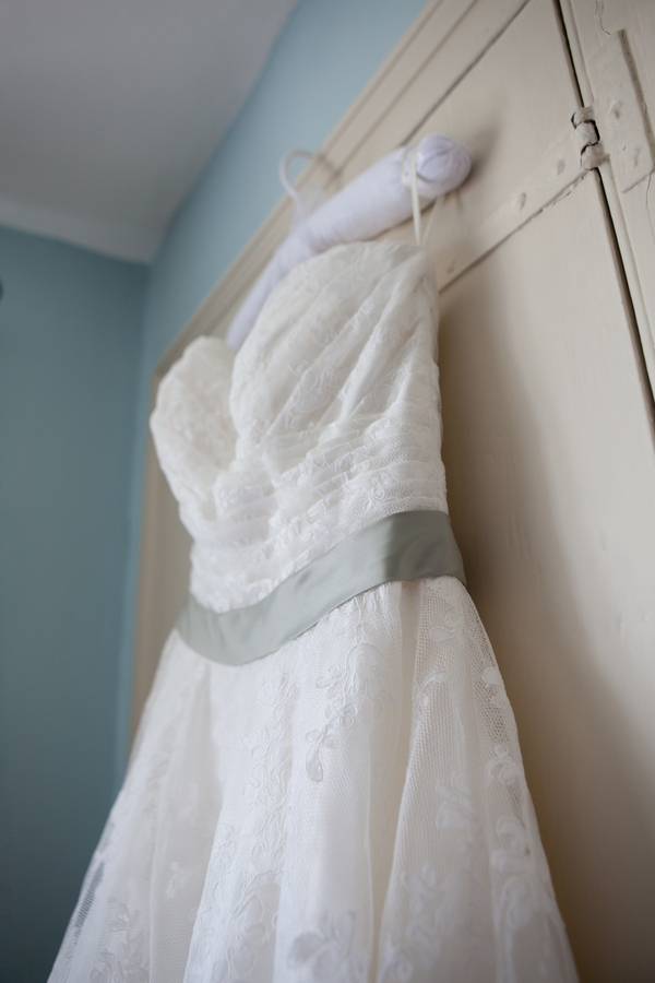 Wedding dress with green sash
