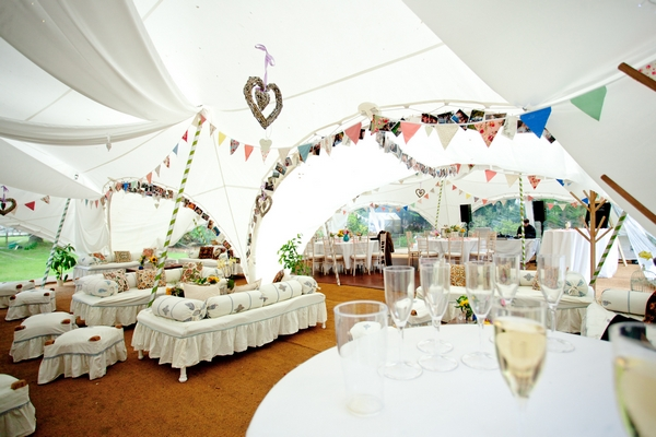 A fun relaxed and pretty garden wedding with funfair for Indoor marquee decoration