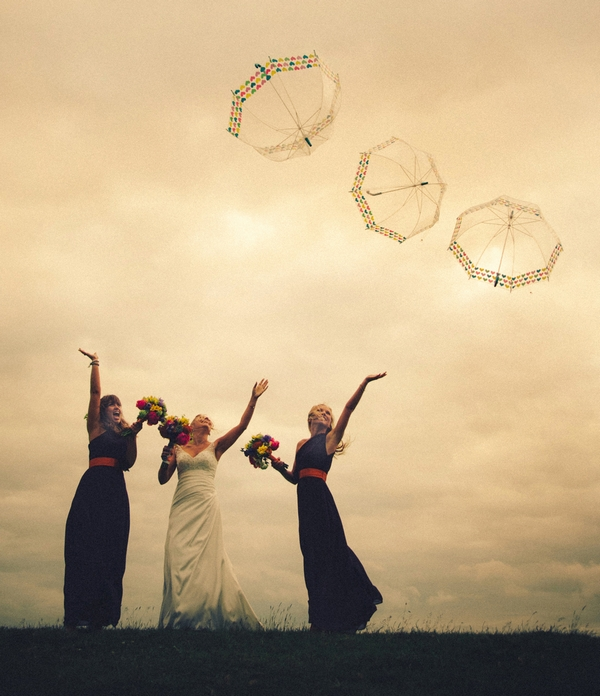 Bride and bridesmaids throwing umbrellas in the air - Picture by DSB Creative