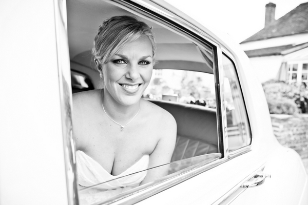 Bride in wedding car