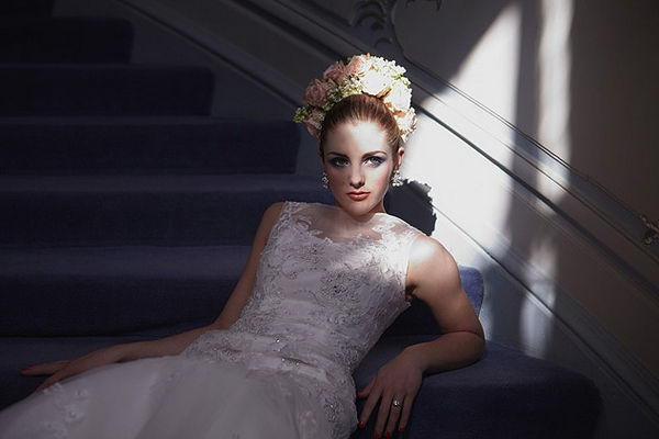 Bride leaning on stairs - Hair and Makeup by Claire Salter