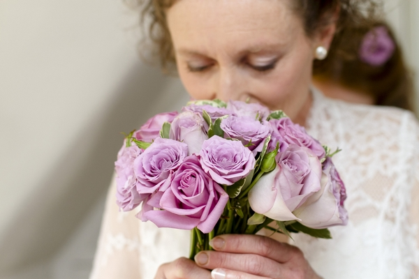 Bride smelling bouquet
