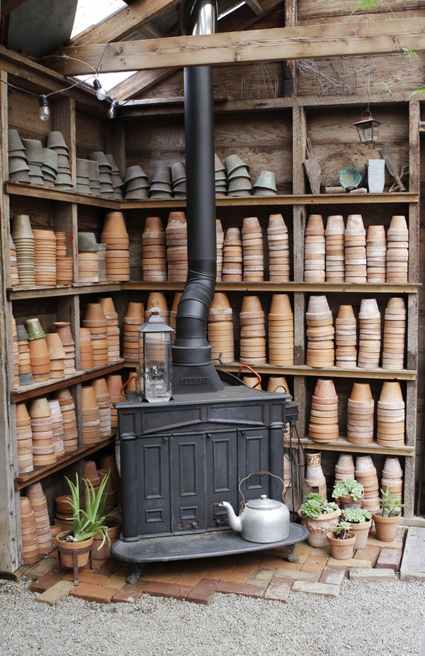 Old stove with shelves of pots