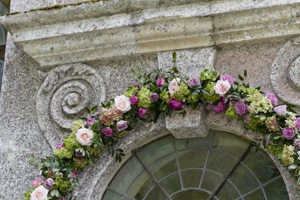 Flowers around top of church window