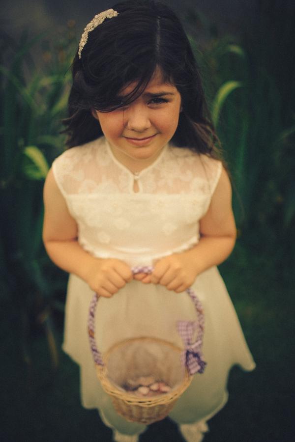 Flower girl holding basket