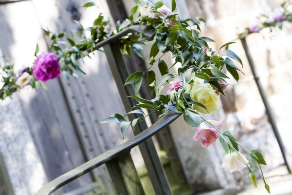Flowers around church railings