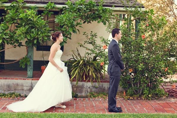 Bride walking up behind groom