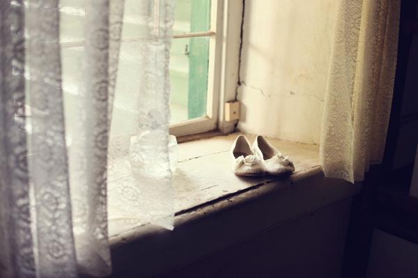 Bridal shoes on window ledge