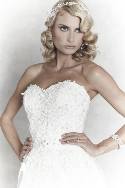Bride with hands on hips - Hair and Makeup by Claire Salter