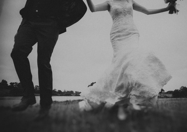 Bride and groom running at camera