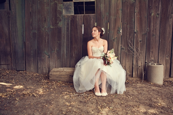 Bride sitting in barn