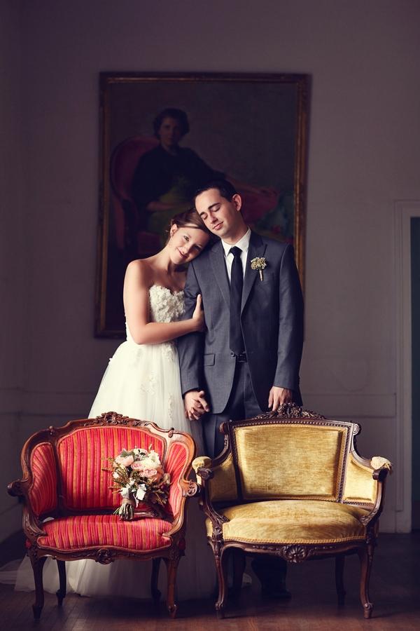 Bride with head on groom's shoulder